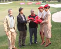 Emirates cabin crew distributing Emirates caps to visitors for the Spot the Cap competition