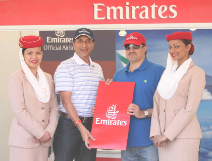 Vinay Malhotra presenting the Spot the Cap winner with a pair of return tickets to either Dallas or Seattle
