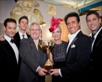 Richard Vaughan, Emirates' Divisional Senior Vice President, Commercial Operations Worldwide with Lisa Vaughan and members of Il Divo in Emirates' St Petersburg-themed marquee on Emirates Melbourne Cup Day.