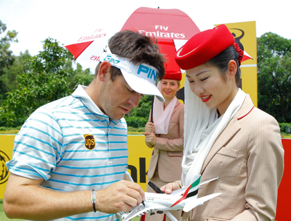 Louis Oosthuizen signing an Emirates A380 aircraft during the pro am day