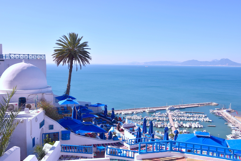Sidi Bou Said,  an artistry spot located on top of a steep cliff and overlooks the Mediterranean Sea.