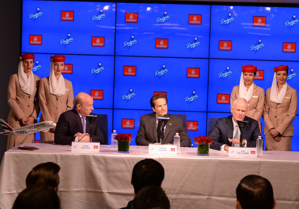 Emirates and LA Dodgers Press Conference - From Left to Right: Emirates Cabin Crew;  Stan Kasten, President and CEO of the Los Angeles Dodgers; Peter Guber, Co-Owner of the Los Angeles Dodgers; Sir Tim Clark, President of Emirates Airline; Emirates Cabin Crew.