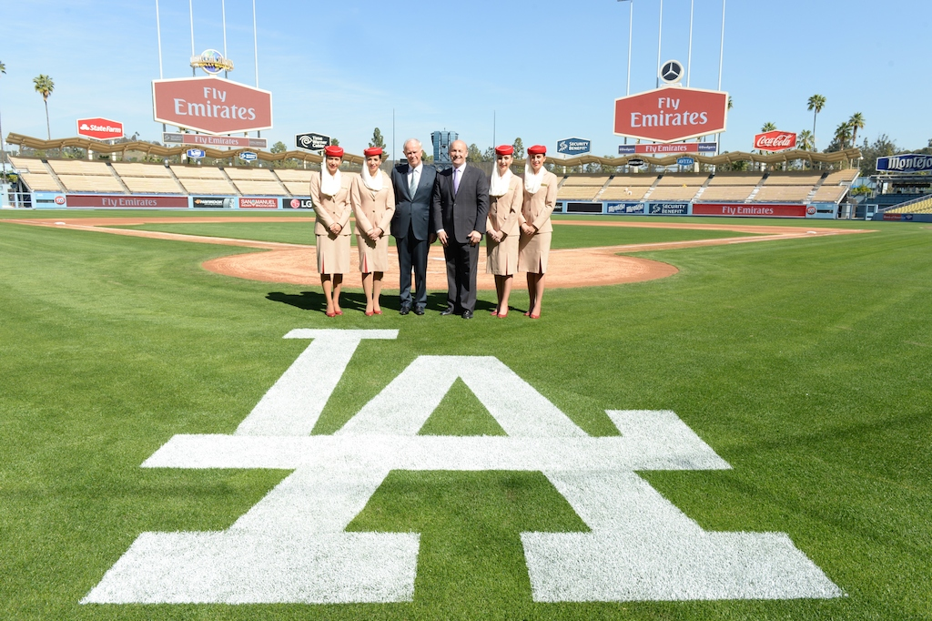 Emirates and LA Dodgers Press Conference - Dodger Stadium Field. From left to right: Emirates Cabin Crew; Sir Tim Clark; Stan Kasten; Emirates Cabin Crew.