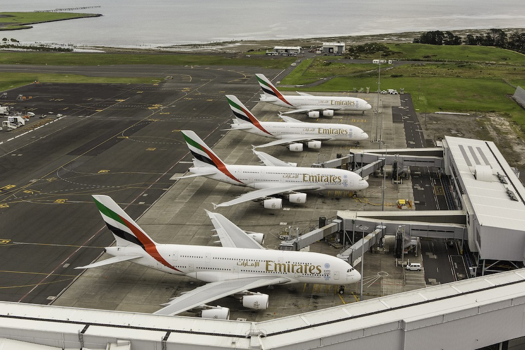 Four Emirates A380 aircraft lined up at Auckland Airport