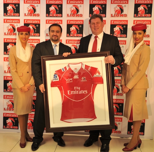 Golden Lions Rugby Union CEO Rudolf Straeuli (right) presents Emirates Senior Vice President Orhan Abbas (left) with the new Emirates Lions jersey