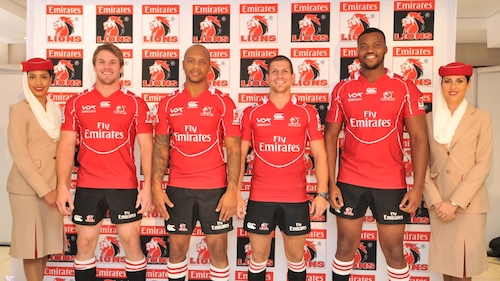 Emirates Lions players in the new playing kit, sporting the Fly Emirates logo. From left to right: Jaco Kriel, Lionel Mapoe, Marnitz Boshoff and MB Lusaseni, flanked by Emirates cabin crew.