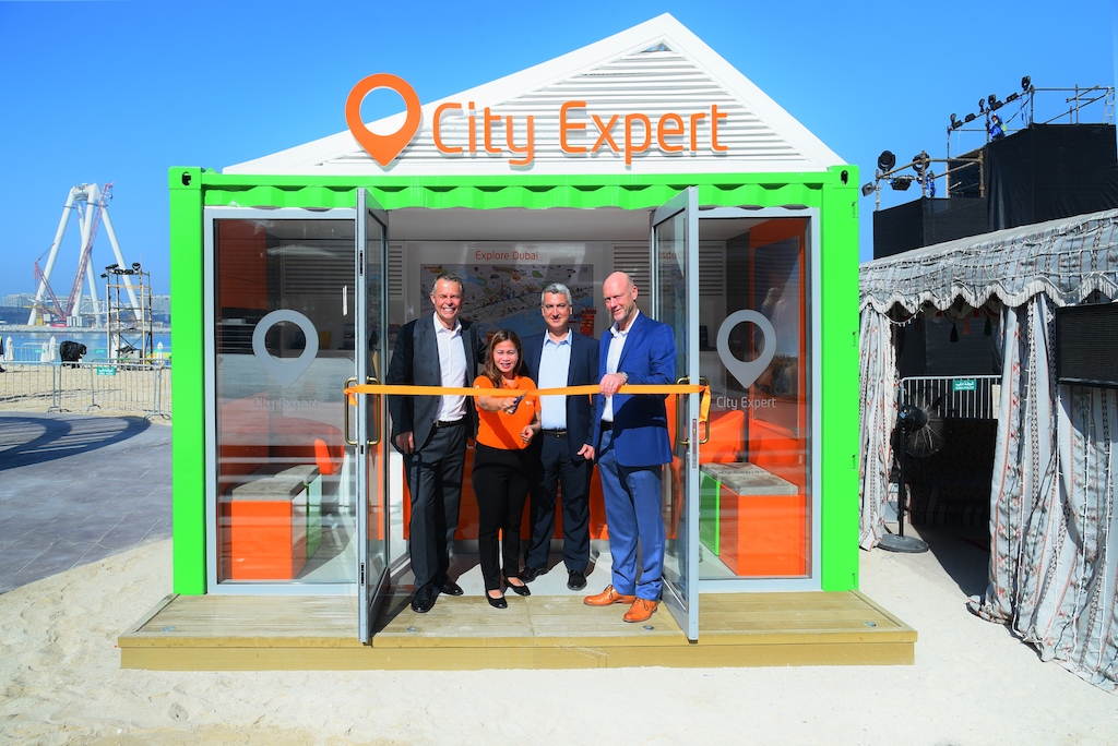 City Expert kiosk at Dubai's JBR - opened by Steve Barrass - SVP Supplier Relations - dnata Travel, Nina Magtoto, sales representative at City Expert, Manuel Rios Operations Manager dnata Travel, and Simon Mead, Manager Operations Arabian Adventures
