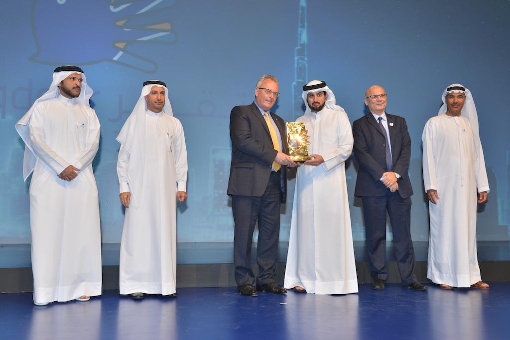 His Highness Sheikh Ahmed bin Mohammed bin Rashid Al Maktoum, Chairman of the Mohammed bin Rashid Al Maktoum Foundation presents the Taqdeer Award to Bernd Struck SVP UAE Cargo, dnata.