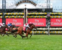 Applegate, ridden by Kerrin McEvoy, wins the Emirates Airline Plate, the first race on Emirates Melbourne Cup Day.