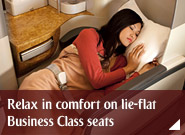 Relax in comfort on lie-flat Business Class seats