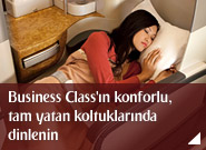 Business Class'ın konforlu, tam yatan koltuklarında dinlenin